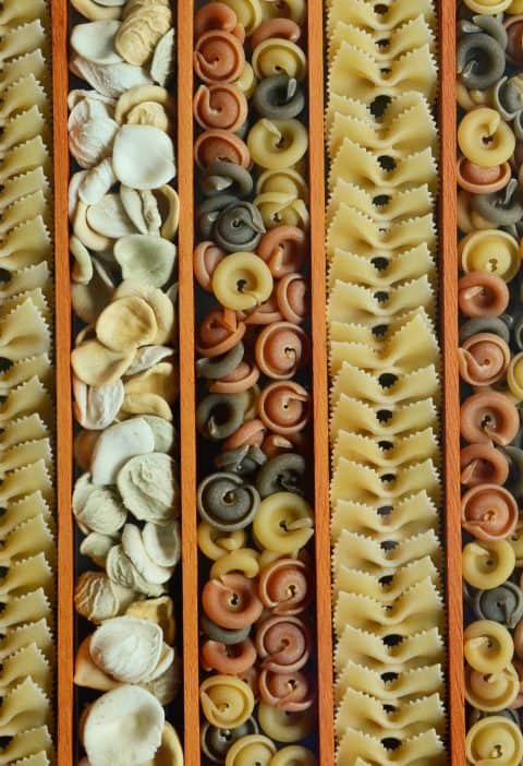 Rows of Uncooked Pasta of different shapes and color